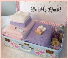 Guest supplies in painted vintage suitcase