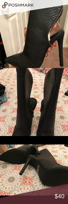 """Shield Me Boots - FASHION NOVA NEVER WORN Size 8 black faux leather/snake """"shield me boots"""" from fashion nova. I never wore them, I just got 2 of the same shoe when I bought them. Heel is between 4""""-5"""" from beginning of  the heel to the bottom. They are pretty comfy. New with no tags. Comes with the fashion nova dust bags. Fashion Nova Shoes Ankle Boots & Booties"""
