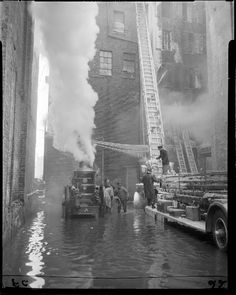 Five alarm fire and ice covered engine, Haymarket area of Boston, February 1954.