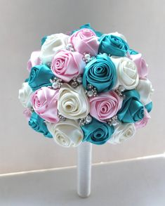 This lovely satin rose bouquet is is perfect for a memorable wedding ! The listing is refer to 1 Medium Bouquet    The sphere is approximately 7