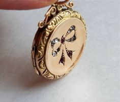 Antique Locket 9 Carat Gold Bow Design by thecaravancollection