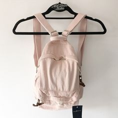 BNWT pink mini backpack There are natural color variations as this is a treated garment, and color may vary! I have 2 available now so let me know which one you would like to purchase. Brandy Melville Bags Backpacks