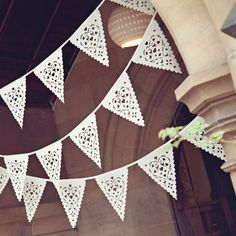 Wedding bunting in lovely lace effect lovebird pattern, perfect venue decoration.@Louise Bowler