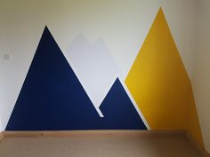 Kids room - mountain decor in navy blue and yellow. Valspar blue dusk and golden beet with white lightning on a background of Dulux white mist. Frog tape lines! Kids Room Bed, Kids Room Curtains, Ikea Kids Room, Kids Room Paint, Kids Room Wall Art, Yellow Playroom, Yellow Kids Rooms, White Girls Rooms, Room Wall Painting