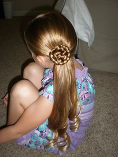side pony tail.  braid top piece and make rose.  secure with bobby pins