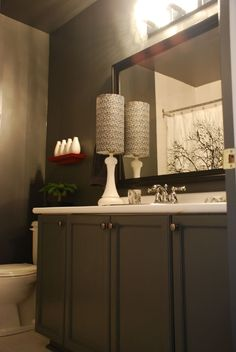 Looks like an older home just painted cabinets and updated the rest......great smaller space bathroom