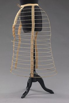 Period crinoline hoop skirt cage. This type of cage would provide more volume around the hips for the skirts to rest on. This is made of linen and metal products.