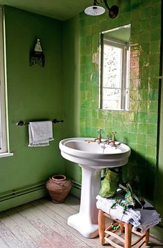 Agnes Emery bathroom. That color of green...the shiny tiles, free-standing sink, and unfinished wood flooring!