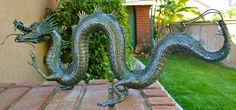 Chinese Water Dragon steel sculpture 4 feet long. Conceived and built by Artist Sculptor Greg Coffelt.