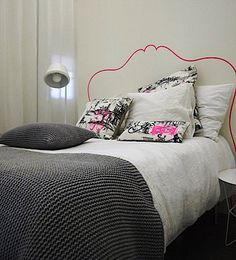 DIY headboard painted on wall grey gray pink bedroom feature wall