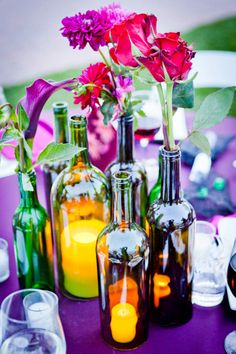 7 wine bottle centerpieces you can DIY for your wedding day! Wine Bottle Centerpieces, Wedding Wine Bottles, Bottle Candles, Diy Centerpieces, Vases, Wine Candles, Summer Wedding Centerpieces, Reception Decorations, Table Decorations