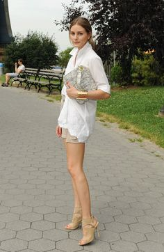 classy- crisp white shirt, tan shorts, nude heels and a great bag