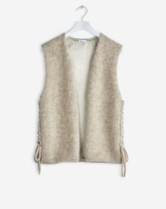 Knitted mohair vest, fully lined with woven satin. Tie detail at sides. <br> <br> - Textured mohair knit <br> - Tie details at side <br> - fully lined <br><br> The model is and wears size S. Blue Christmas, Winter Collection, Knitwear, Vest, Satin, Woman, Knitting, Detail, Pretty