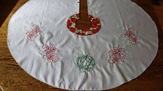 Items similar to Christmas Tree Skirt Embroidered with Wreath and Poinsettias on Etsy Poinsettia, Tree Skirts, Christmas Tree, Wreaths, Embroidery, Holiday Decor, Cotton, Handmade, Etsy