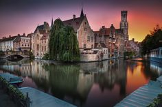 Bruges, famous Belgian city, under a very strong and colorful sunset by Stefano Termanini
