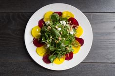 Raw beets with arugula, goat cheese, and hazelnuts –delicious even if you normally don't like beets!