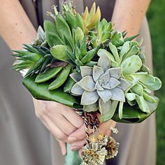 """An untraditional bouquet full of plants and greenery with a focus on aloe. """"New Life"""" Wedding. Green wedding! #green #newlife #aloe #greenery #plants #wedding #weddingideas #bridal #bouquet #bridalbouquet www.gmichaelsalon.com Green Wedding, Happily Ever After, Grandkids, No Time For Me, Aloe, Weddingideas, Greenery, Succulents, Wedding Planning"""