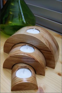 This candleholder set is simply beautiful. We laminated together Camphor and Maple woods creating a solid block of wood. Then cut out each individual piece. Looking at the third picture you can see how we cut the individual pieces from the solid block of wood. Notice how the grains line up. Finally we added a recess for each tea light candle to fit into. It is then finished with a crystal clear gloss lacquer to show off the natural color and characteristics of the wood. $35