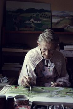 one hundred-year-old artist Grandma Moses (1860-1961) painting at her farm in 1960