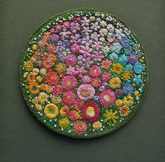Embroidered floral circle.