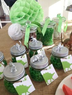 Dinosaur party favors - Inexpensive plastic dinosaurs and glass jars are transformed into keepsakes -- with the help of a little metallic spray paint. Then just fill the jars with candy and you've got your dinosaur party favor.