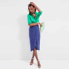 J.Crew Looks We Love: women's perfect shirt in linen, tulip faux-wrap skirt in indigo ikat, iridescent hologram clutch and painted flower bracelet.
