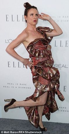 Goofing around: Juliette Lewis certainly turned heads in a fussy layered one-shouldered nu...