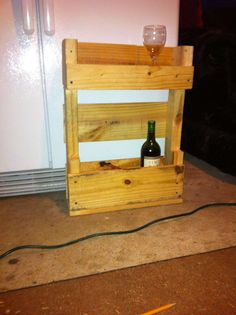 Awesome Pallets Wall Wine Rack  #kitchen #palletwall #palletwinerack #recyclingwoodpallets #usedpalletracks We had made some wine racks (also shown) in the past and had a few extra Ball jars around and voila! We simply cut a pallet in half, then half again. ...