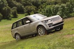 Range Rover driving up hill.