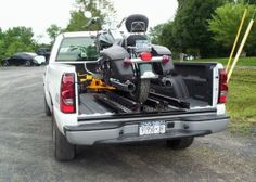 Overbilt Lifts provides electric motorcycle lifts and motorcycle carriers for your RV, Motor Home, or pickup truck, as well as golf cart carriers and trailers and ATV carriers and trailers