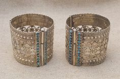 Afghanistan/Pakistan | A pair of vintage silver hinged bracelets from the Kuchi people | Silver and turquoise glass stones.