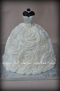Gown is 9, 8, 8, 6 cakes, stacked and carved slightly; crumb-coated and then covered with buttercream rosettes using 1M tip.  Bodice is fondant over barbie doll body (no legs