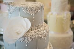 Delicate lace duck egg blue wedding cake.  www.choosecake.co.uk.  Image taken by Avenue White Photography at The Wedding Affair at Goldsborough Hall, June 2014