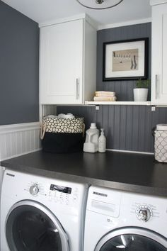 You don't have to skimp on style to make your laundry room more efficient!  Cabinets to match your washer and a dark counter that matches your walls adds both form and function!