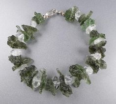 Genuine Moldavite raw pices bracelet about 21 cm long with sterling silver closing.This is handmade unique item,you get what is on the picture. Ring Bracelet, Silver Bracelets, Free Gifts, Floral Wreath, Pendants, Sterling Silver, Crystals, Stone, Diamond