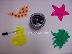 Water Droppers - use the backs of tub grips, a dropper, and some colored water.