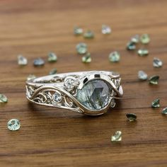 A #GreenLakeJewelry favorite with a rose cut center! #MontanaSapphire #MadeInAmerica #EngagementRing