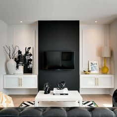Black and white living room with yellow accents. Contemporary living room boasts black leather ...