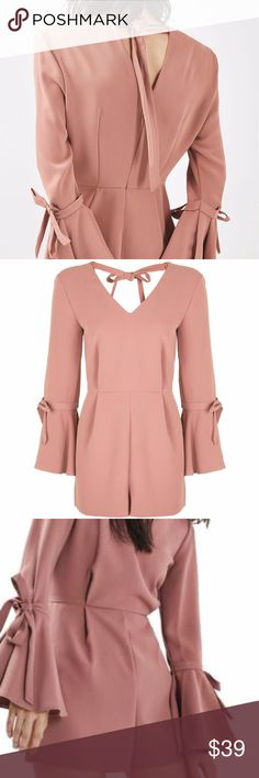 NWT Topshop TALL Tie Trumpet Sleeve Playsuit Rose Super stylish and comfy. From non-smoking, non-pet home.   Add to bundle to save on shipping costs! Don't forget to add any two things in my closet and receive an extra 10% off! no trades.  About me: Please buy with confidence. I work to make sure my clients are happy! I buy similar styles, trends, brands and sizes, please follow me to see new styles added every day. Topshop Pants Jumpsuits & Rompers