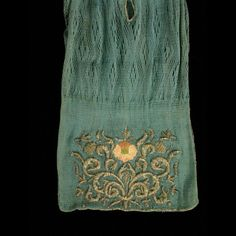 """Stocking purse, sprang and metallic needlework 1650-1720 Origin: England or Europe L: 19 3/4""""; W: (at bottom): 6"""" Silk sprang embroidered with silk and metallic threads on silk cores Gift of Anonymous Donors Acc. No. 1971-1421"""