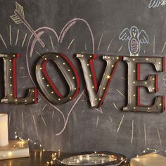 "Proclaim your affection every day of the year with these 15 inch tall metal letters of devotion. Small lights raise the quiver factor. Uses AA batteries. brbrliDimensions: 15"" highliBRBR..."