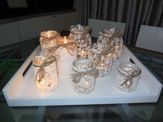 portacandele fatti con barattoli di vetro vari (marmellata, nutella, olive, ecc...) rivestiti con vecchi centrini dimenticati nei cassetti