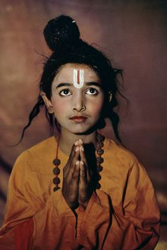 This boy, part of acting troupe, is dressed as mythological figure in Mumbai, India.
