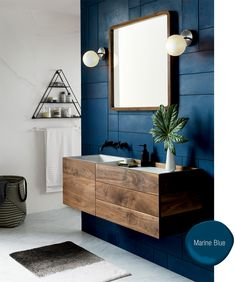 Modern bathroom design with blue accent wall, floating vanity, and square mirror. Wood Bathroom, Bathroom Furniture, Bathroom Ideas, Bathroom Black, Master Bathroom, Bathroom Cabinets, Colorful Bathroom, Blue Cabinets, Mirror Bathroom
