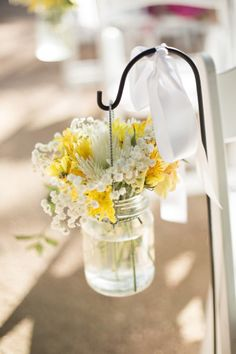 Shepard's hooks lining the aisle with mason jars full of flowers! Have several, but need to get a few more.