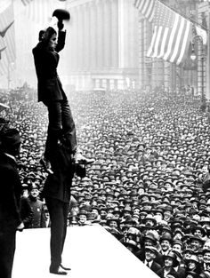 Charlie Chaplin at the age of 29, in front of a crowd in 1918, Lower Manhattan, New York, appearing with Douglas Fairbanks, Sr. during WWI. They were promoting war bonds for Third Liberty Loan.