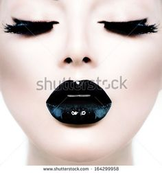 High Fashion Beauty Model Girl with Black Make up and Long Lushes. Black Lips. Dark Lipstick and White Skin. Vogue Style Portrait - stock photo