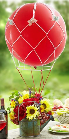 Use a helium filled balloon as a hot air balloon centerpiece. Would be fun decorations for a party!