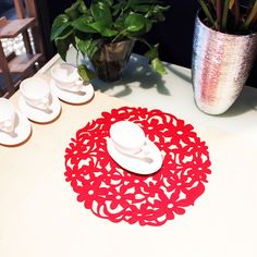Hollow design wool felt coaster with red color. Unique design to decorate your table and protect your table surface from heat.