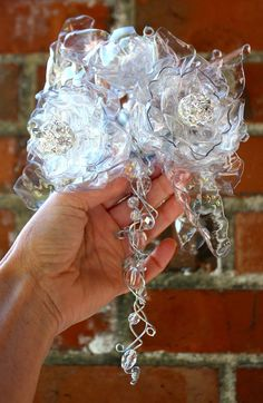 Wedding Flower Bouquet, Glass Like Jeweled Brooch, Crystal Clear Alternative Beaded BouquetArt Of Using Plastic Flowers To The Best Advantage - Bored Art Plastic Spoon Art, Plastic Bottle Flowers, Plastic Bottle Crafts, Recycle Plastic Bottles, Purple Wedding Bouquets, Flower Bouquet Wedding, Recycled Bottles, Recycled Crafts, Beaded Bouquet